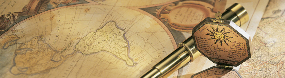 Antique Spyglass and Compass on World Map